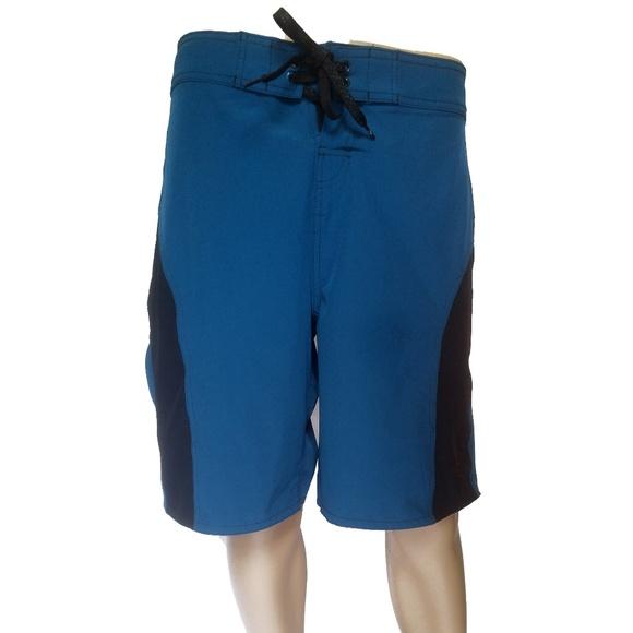 3ad5f95bf0fa1 OP Swim   Nwot 4 Way Flex Blue Board Shorts Size 34   Poshmark